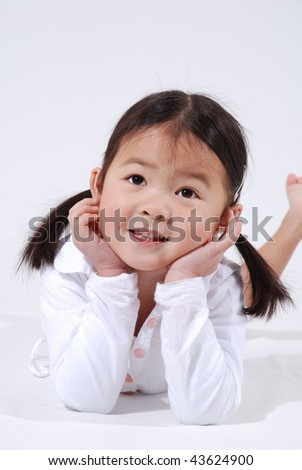 little asian girl with pig tails in a white dress - stock photo