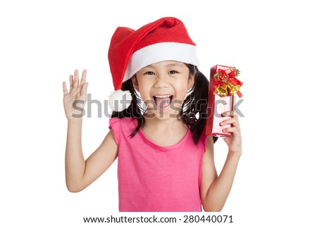Little asian girl with santa hat and gift box  isolated on white background - stock photo