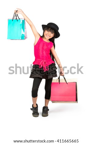 Little asian girl with shopping bags, Isolated over white
