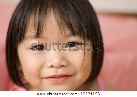 little asian girl with smiling face