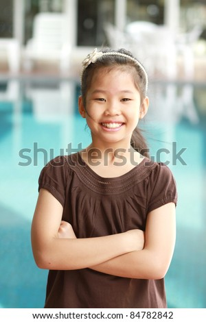 Little asian girl with smiling face - stock photo