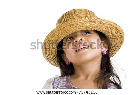 little asian girl with straw hat looking up over white - stock photo