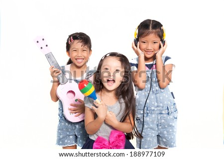 Little asian girls singing a song isolate on white background