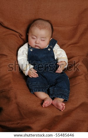 Little Asian infant baby boy sleeping
