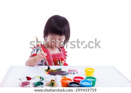 Little asian (thai) girl painting and using multicolored drawing instruments, creativity learning education,on white background, studio shot - stock photo
