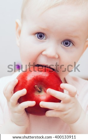little baby and an red apple