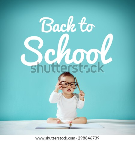 "Little baby and blackboard with ""back to school"" on background, School concept - stock photo"