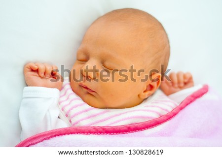 little baby are sleeping in bed - stock photo