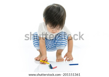 Little baby asian is writing - stock photo
