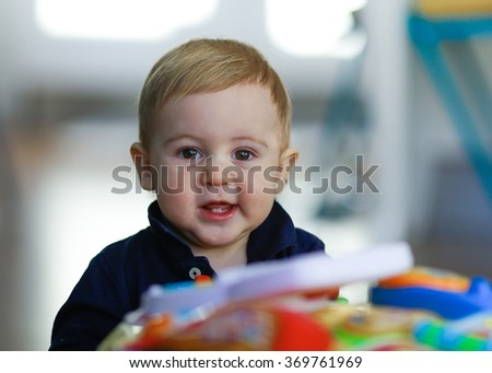 Little baby blonde hair play at home - stock photo