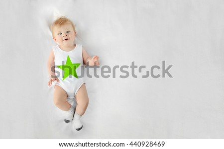 Little baby boy lying on the bed - stock photo