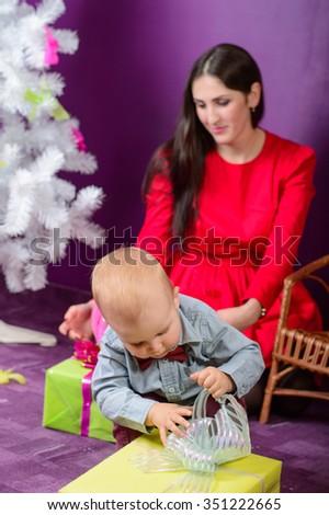 Little baby Boy Opening Christmas Present  - stock photo