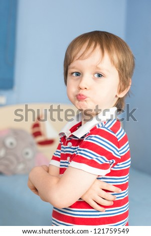 Little baby boy starting to be offended - stock photo