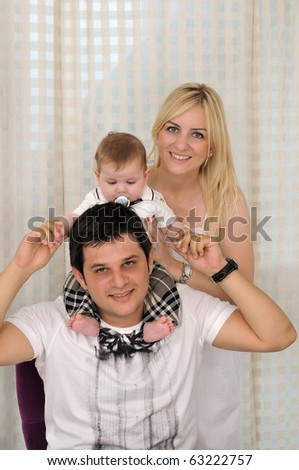 Little baby boy with his family - a series of BABY images. - stock photo