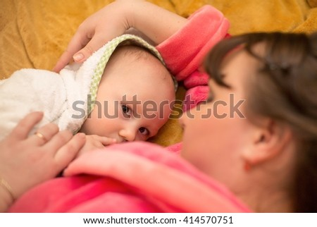 Little baby boy with mother - stock photo