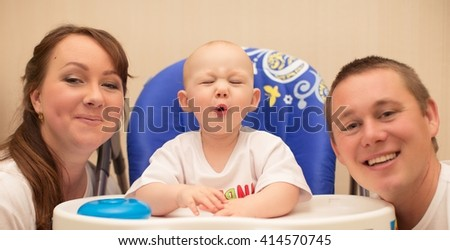 Little baby boy with parents - stock photo