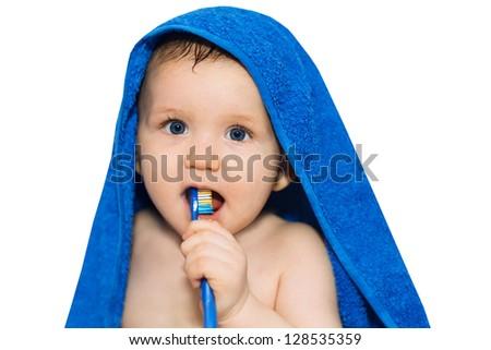 Little baby brushing his teeth - stock photo