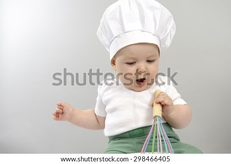 little baby chef, 7 months old - stock photo