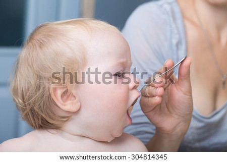little baby child eat from a spoon