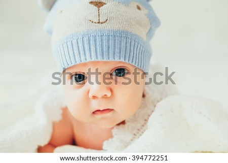 little baby (child) lying in a white knitted blanket. newborn. son. boy.
