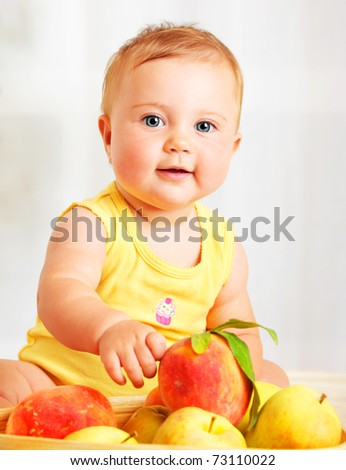 Little baby choosing fruits, closeup portrait, concept of health care & healthy child nutrition - stock photo
