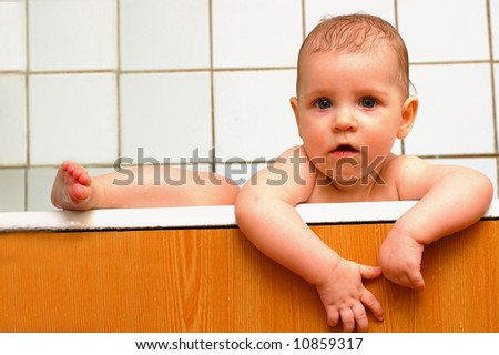little baby climbing out from a bath, portrait, close-up