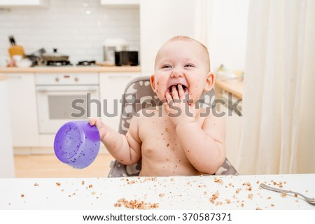 Little baby eating. Happy messy eater - stock photo