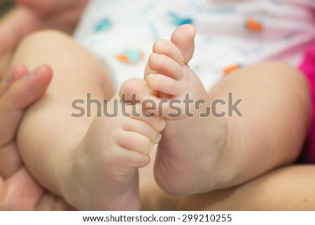 little baby feet and smiling on white
