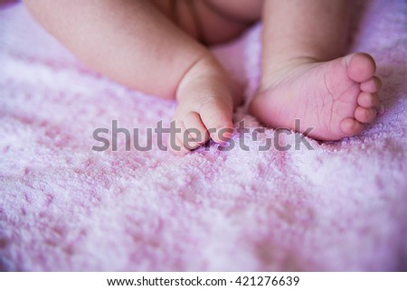 little baby feet, close up on purple
