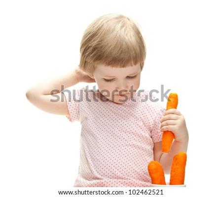 Little baby girl eating fresh carrot isolated on white - stock photo