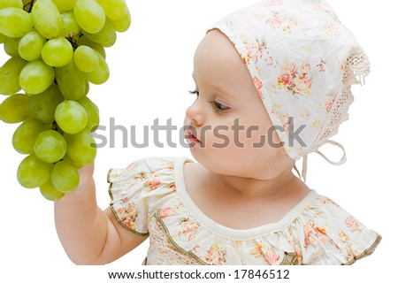 Little baby girl eats big grapes, isolated on white - stock photo