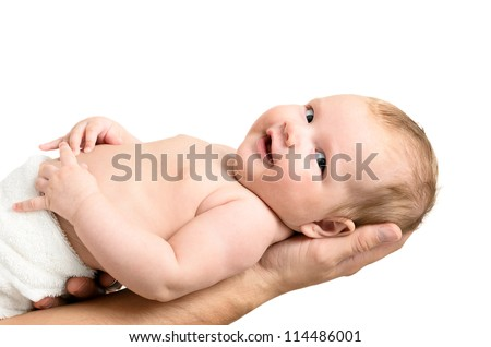 Little baby girl held carefully by father's hands, isolated on white background - stock photo