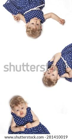Little baby girl in blue dress lying on white background - stock photo