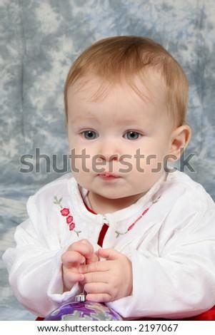 Little Baby Girl in Christmas dress - stock photo