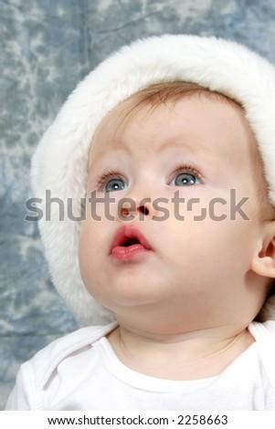 Little Baby Girl in Christmas Hat - stock photo