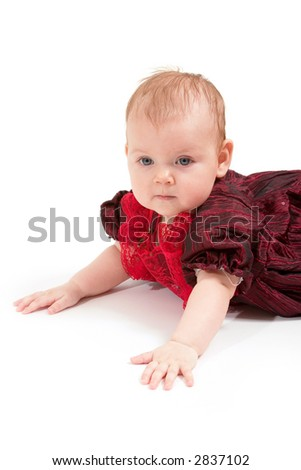 Little baby girl in formal red dress. Copy space is on the left top.