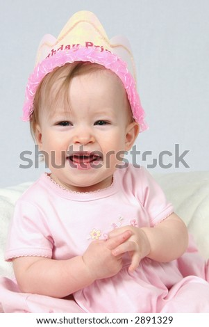 Little Baby Girl in Pink dress and birthday hat