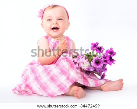 little baby girl in pink dress  and bouquet  flowers - stock photo