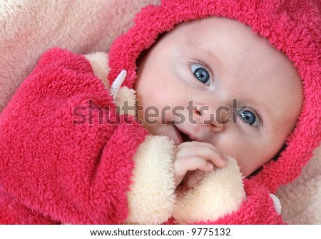 Little baby girl in pink smiling - stock photo