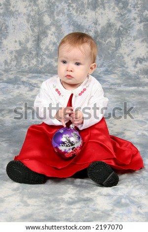 Little Baby Girl in red Christmas dress - stock photo