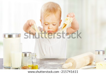 Little baby girl is cooking, kneads dough baking, pastry rolls out - stock photo