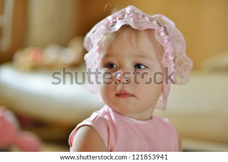 little baby girl looking left - stock photo