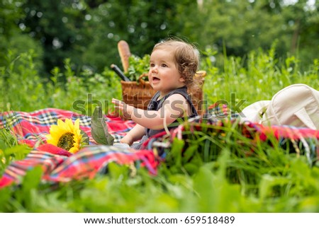 Little baby girl on picnic in nature
