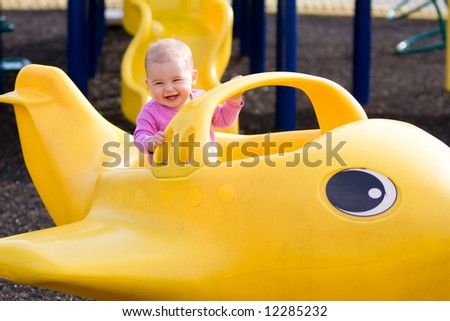 Little baby girl on playground - stock photo