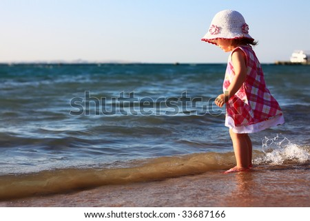 Little baby girl on the beach