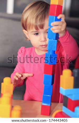 Little baby girl  playing with blocks