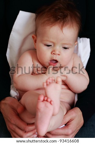 little baby-girl sitting on her mother's hands