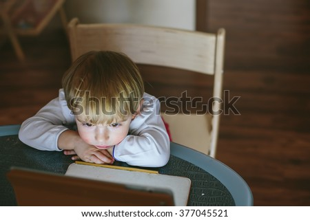 Little baby Girl sitting with laptop computer - stock photo