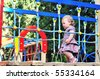 Little baby girl walking on playground in the park - stock photo