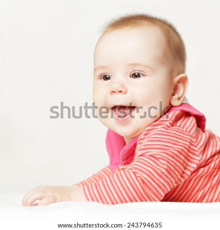Little baby girl wearing a red clothes - stock photo